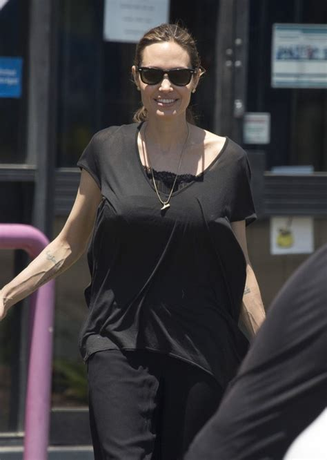 Angelina Jolie Shops For Halloween Supplies WIth Her Kids ...