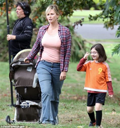 Charlize Theron shows fuller figure on set of Tully amid ...