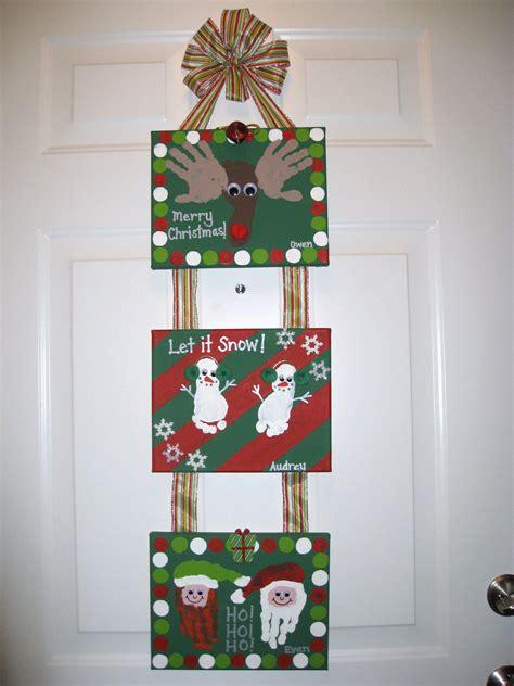 Christmas Handprint Footprint Canvas Craft | Kid craft ...