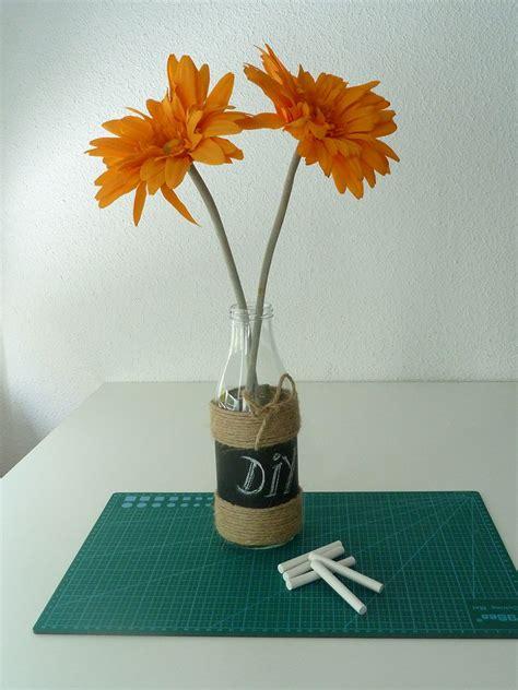 Cómo decorar una botella de cristal para hacer un florero