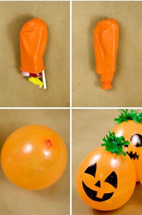 Cómo hacer dulceros con globos para Halloween ...