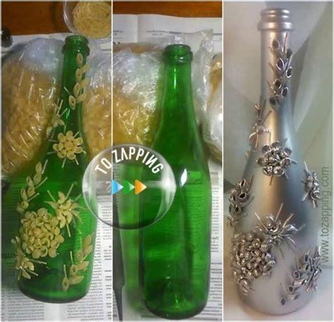 Florero con botellas de cristal   Tozapping.com