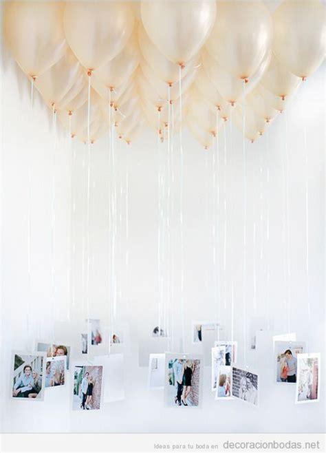 Globos de helio con fotos de los novios colgando ...