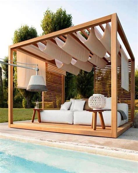 Ideas para decorar jardines con piscina