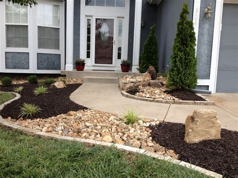 New landscape with stone edging, dry river creeks and a ...