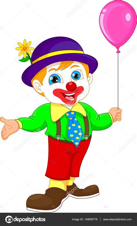 niño de dibujos animados de traje de payaso con globo ...
